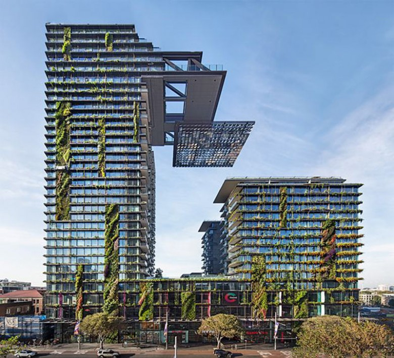 tall glass building with vertical gardens