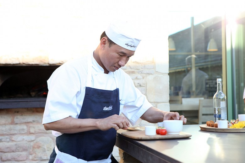 Picture of Kittuya Nimcean cooking at the Daylesford Chef's Table event