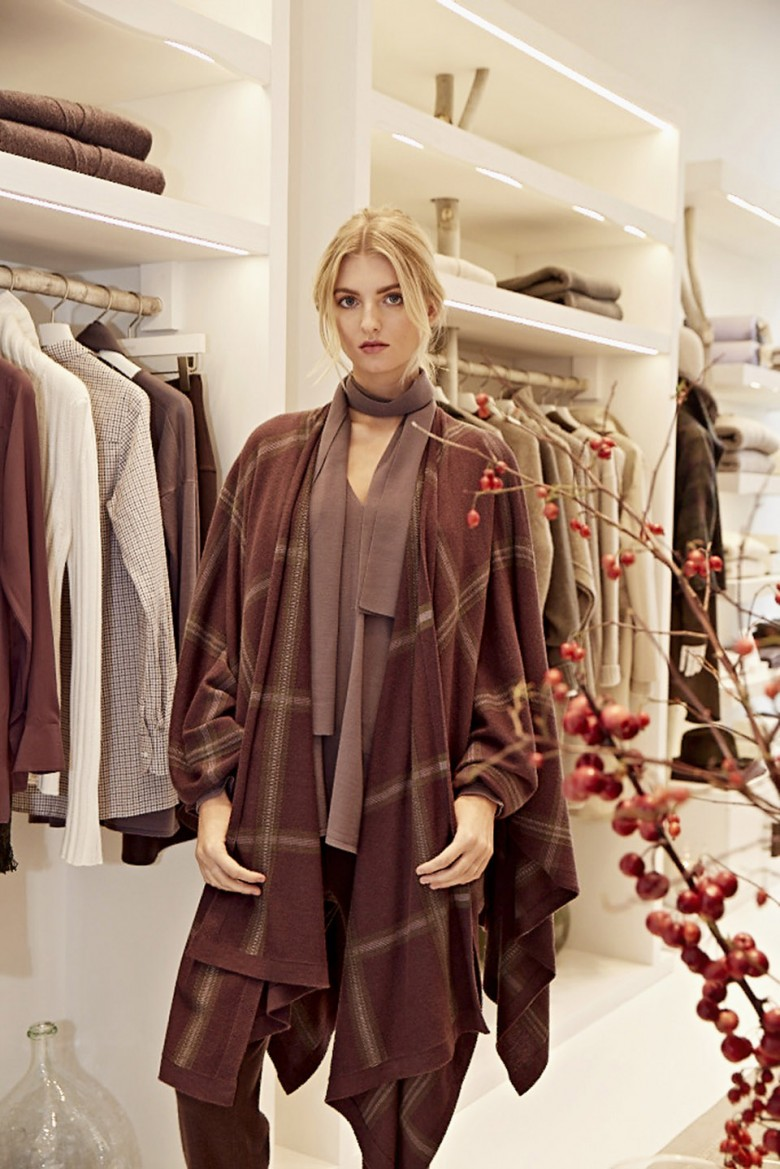 A guest showing off her wonderful outfit at the new Bamford store in South Audley Street