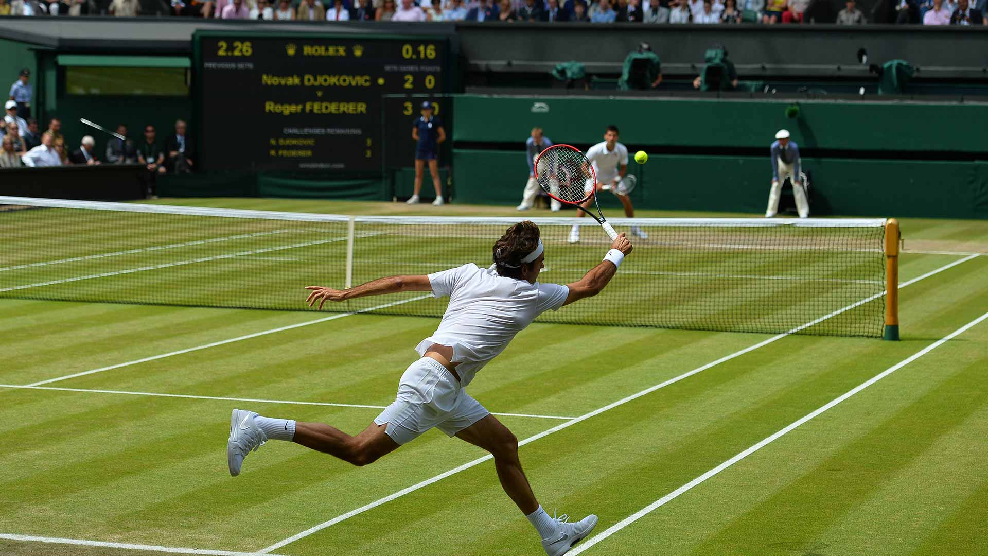 Two tennis players playing on centre court at Wimbledon.
