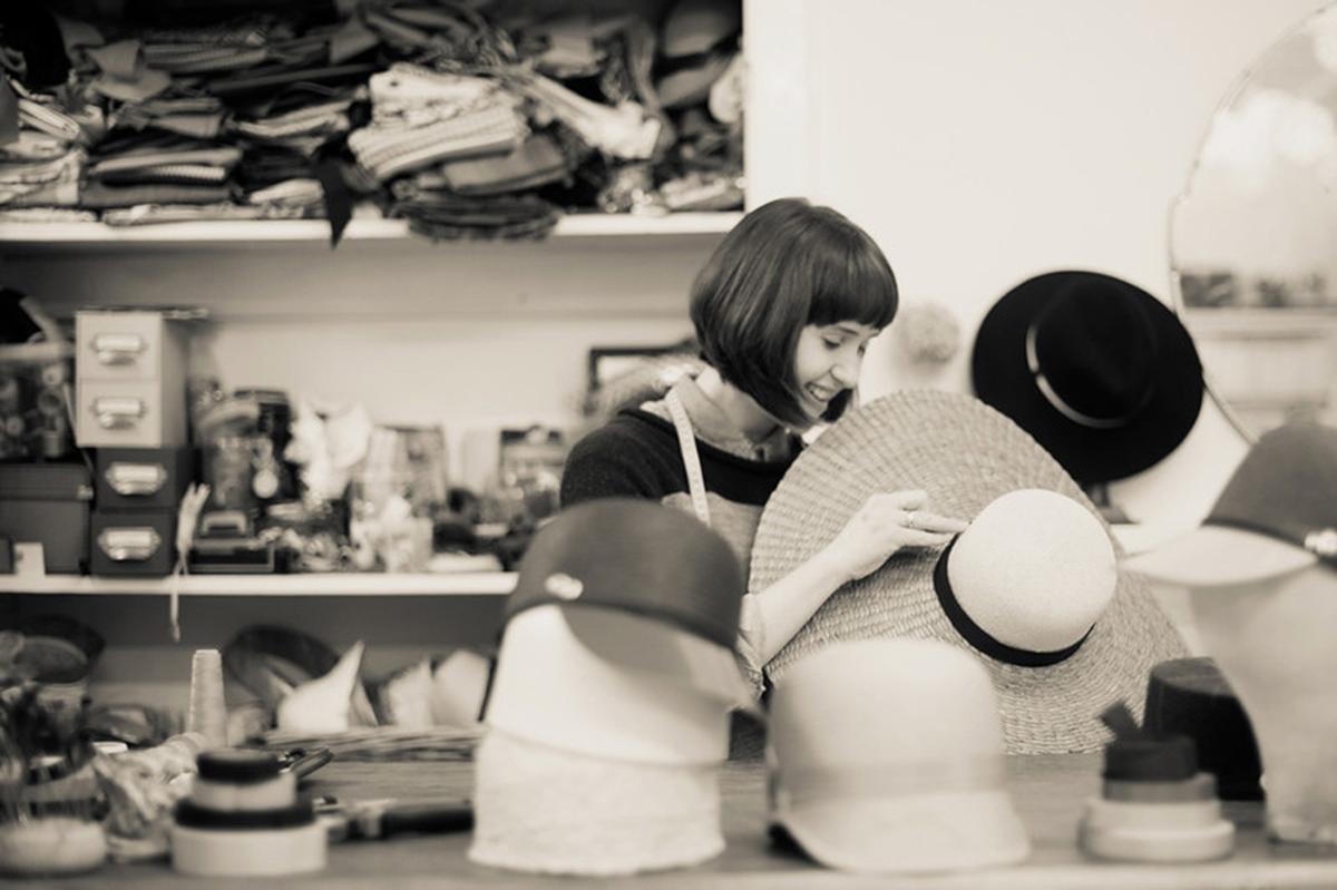 Designer working on a hat in studio