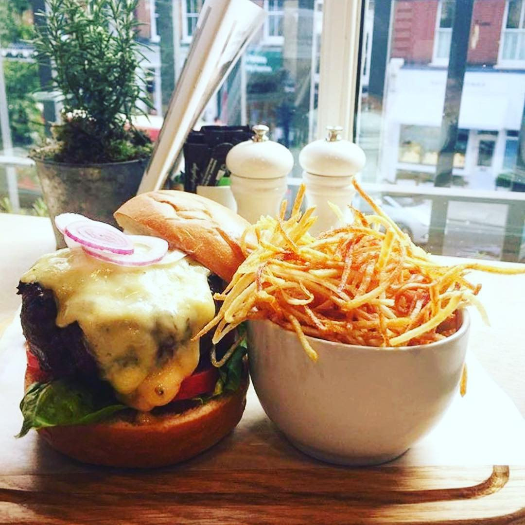 The Daylesford hamburger with a choice of cheddar or blue cheese with beetroot on a homemade bap and truffle chips #no1bestseller #organic