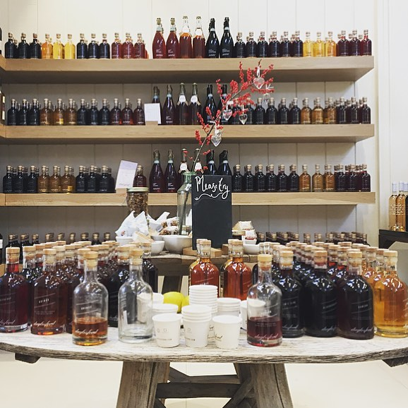 Lots of fruit liqueurs in the Christmas barn #quince #sloe #rhubarb #blackcurrant #raspberry #damson #plum #liqueur #christmas @daylesfordfarm